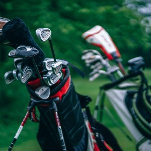 proud-golfer-cleans-clubs